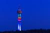 The Kaknästornet TV tower illuminated at night in Stockholm, Sweden.
