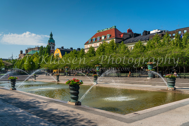 A decorative pond and fountains in a small park near the Nybrokajen ferry terminal, Stockholm, Sweden.