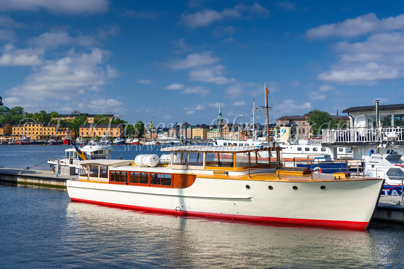 A view of boats, hotels and restaurants at the ferry terminal of Nybrokajen, Stockholm, Sweden.