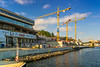The Finnboda hamn brygga fery terminal and construction cranes near Stockholm, Sweden.