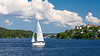 A recreational sailboat along a waterway in Stockholm, Sweden.
