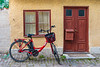 A decorative door and bicycle at a home in Visby, Gotland, Sweden.