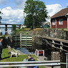 I decided, since in no real hurry to arrive at Gothenburg this Sunday afternoon, I decided, this is the Trip I get off Route 45 and really visit Dalslands Kanal in Håverud.  The man, painting, is a  volunteer for opening these 150 year old locks !