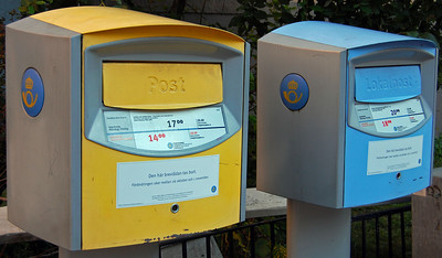 "Swedish mailboxes. Blue is for ""local"" mail, i.e. Stockholm region. Yellow is for the rest of Sweden and the world."