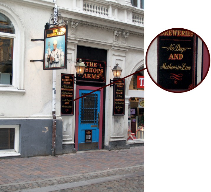 """A pub in Helsingborg. This is an edited version of the previous picture, highlighting the bottom of the left sign where it says """"No Dogs and Mothers-in-Law""""."""