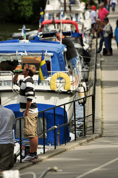 """Spectators along the waterfront enjoying """"refreshments"""" during the race."""