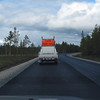 LOTS  FÖLJ MIG !  Due to construction and this was a 5 mile stretch almost...and the road was narrow....in Sweden and Norway....you wait to proceed until this vehicle arrived....with vehicles behind him, from other direction !  The word LOTS.....I had always associated with large ships being escorted in to a harbor......