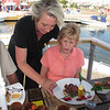 Eva Tagaeus, co owner of Brygghuset restaurant at the end of the docks at Knippla..gourmet dining. Eva is explaining to Margaret the Sampler plate items.