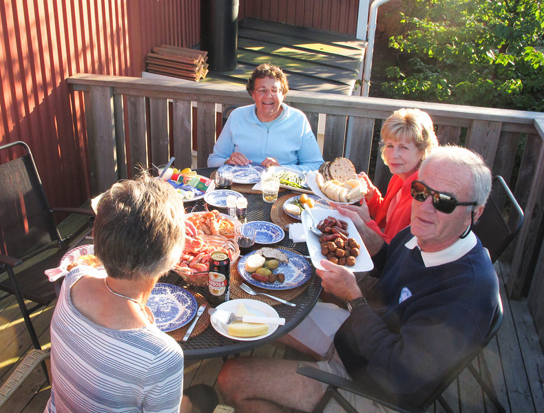 I see beer, wine and ocean crayfish, Margaret holding a basket of breads.. and Chuck holding meatballs....a good start.