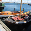 Two older wood boats in good shape.