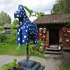 A ceramic gift shop in background...with happy horse sculpture.
