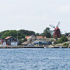 To the left of Windmill, and to the right of sailboat masts...red building...Upper floor is ours.