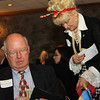 Trisha Allen, Executive Director of British American Chamber getting some Raffle money from Dick Erickson.