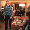 Linda is on a mission to the Christmas tree to decide which package is PERFECT for her.