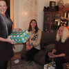 Emily, a guest participant tonight, got in to our White Elephant party quickly !