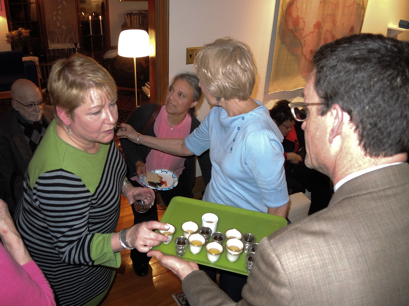 New Swedish Consul Malou Monago, accepting a nubbe from Tom.