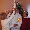 Margaret straightening her husband Chuck's Star Boy hat again.