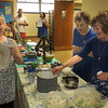 Malou, Marianne and Margerita stirring the meatballs.