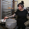 Sweet Lydia's has many treats for you to chose from for Valentine's Day. Employee Jen Simone the ingredients up to the right temperature to make caramel Monday at the shop on Merrimack Street in Lowell. SUN/JOHN LOVE
