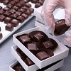 Sweet Lydia's has many treats for you to chose from for Valentine's Day. Some of the dark chocolate salted caramels  being packaged at the shop Monday afternoon on Merrimack Street in Lowell by employee Staar Brandom. SUN/JOHN LOVE