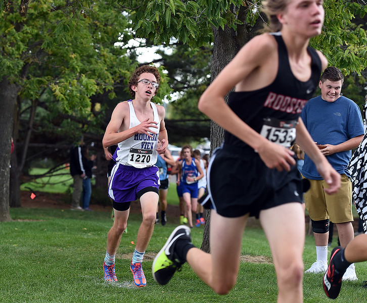 Mountain View's Casey Tripi runs Friday, Sept. 22, 2017, during the Sweetheart cross country meet at North Lake Park in Loveland.   (Photo by Jenny Sparks/Loveland Reporter-Herald)