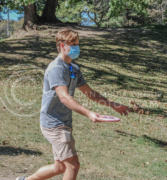 Preparing for a low throw, Micah Sapp anticipates where the disc will go.<br /> Photo By Macey Franko