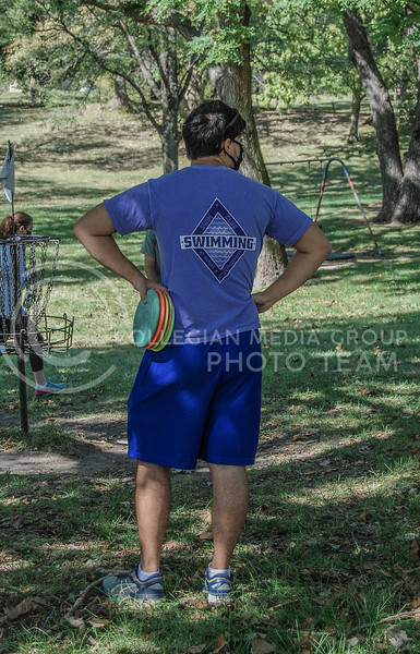 Waiting for his teammates, junior Jake Willenbring looks around the course.<br /> Photo by Macey Franko