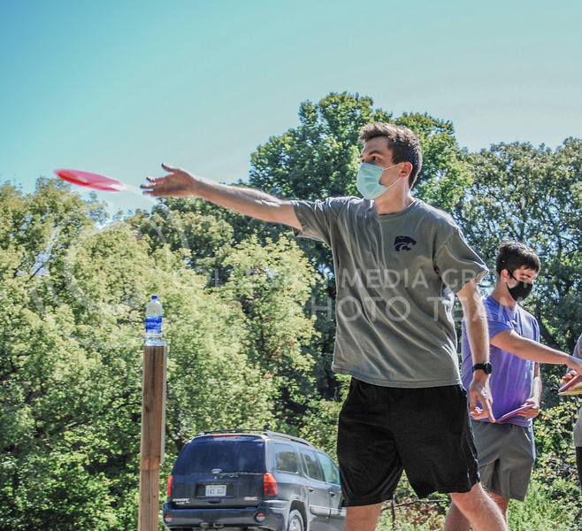 After letting go, Brandon York watches his disc fly down the course.<br /> Photo By Macey Franko