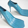 National PIctures<br />  <br />  Pic shows high heels which double as flippers. See copy NnHeels