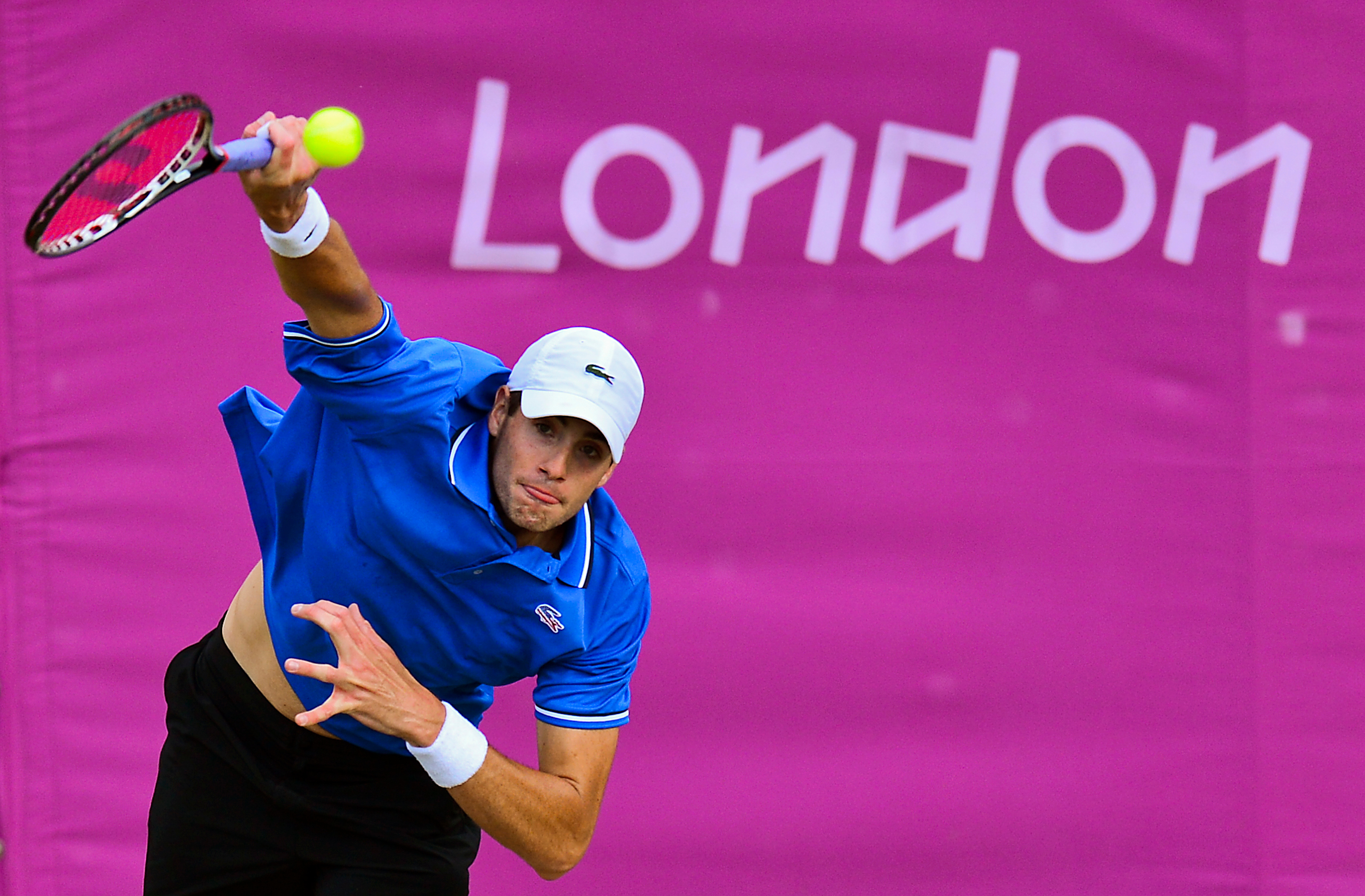John Isner of the US serves the ball to Serbia's Janko Tipsarevic during their men's single tennis match Third round at the London 2012 Olympic Games in London on August 1, 2012. AFP PHOTO/Luis Acosta (Photo credit should read LUIS ACOSTA/AFP/GettyImages)