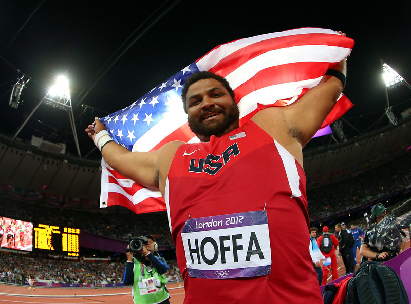 Reese Hoffa of the United States celebrates his bronze medal in the Men's Shot Put Final on Day 7 of the London 2012 Olympic Games at Olympic Stadium on August 3, 2012 in London, England. (Photo by Alexander Hassenstein/Getty Images)