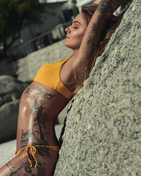 Summer sizzle. Tanned body with some incredible ink, you made the quiet beach come alive.  * *  Model: * *