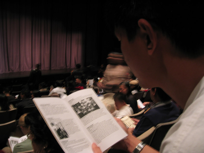 2003 11 15 Saturday - The Movement Showcase - Ben Liu checks program before the show