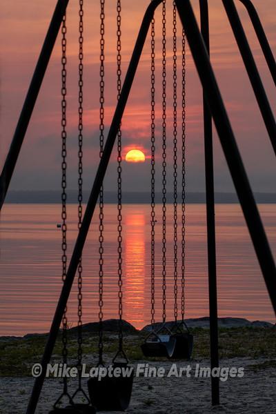 Sunrise Through the Swings