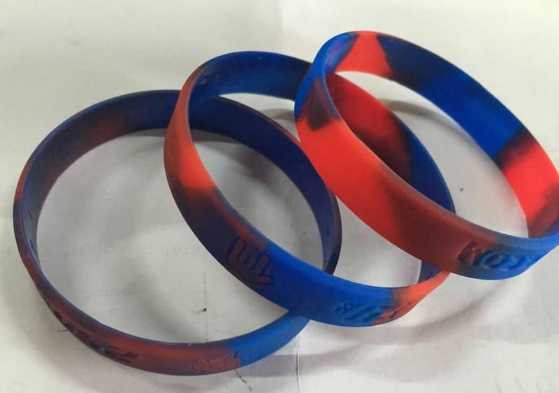 ริสแบนด์คนสีน้ำเงิน+แดง ด้านนอกปั๊มจมไม่ลงสี