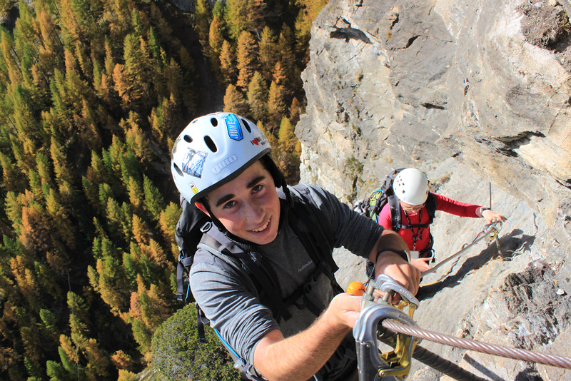 Andrew climbing on the cliffs above Zermatt with Samantha getting ready to follow