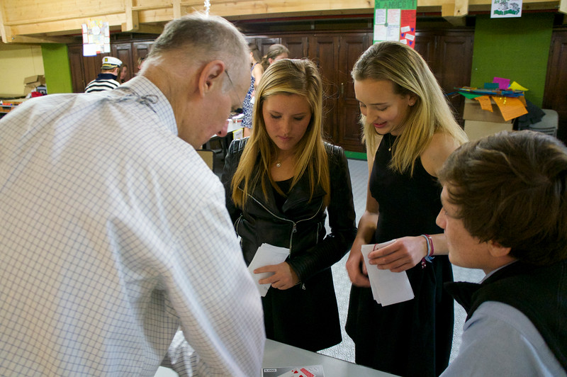 Mr. Hansen explaining some of the finer points of Blackjack to Emily, Paige, and Ryan