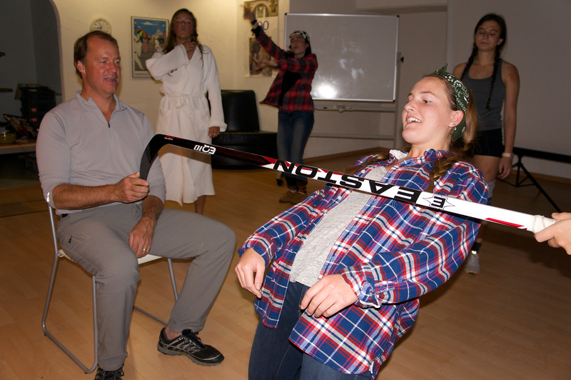 """Mady doing the limbo with KR holding the """"bar"""" and Emily, Janie, and Katerina looking on"""