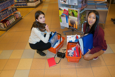 Katerina and Lucy comparing supplies