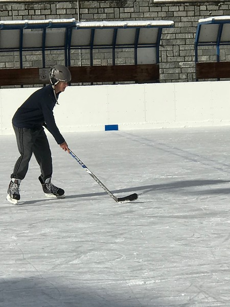 Alex learning to play hockey