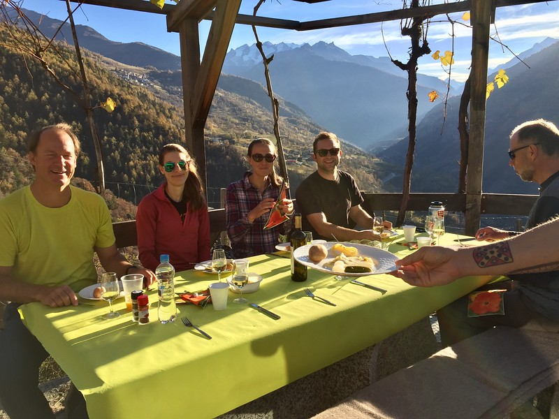 Mr. KR, Ms. Perry, Ms. van Zalinge, Mr. Bollag-Miller, and Mr. Crossman enjoying raclette at Visperterminen