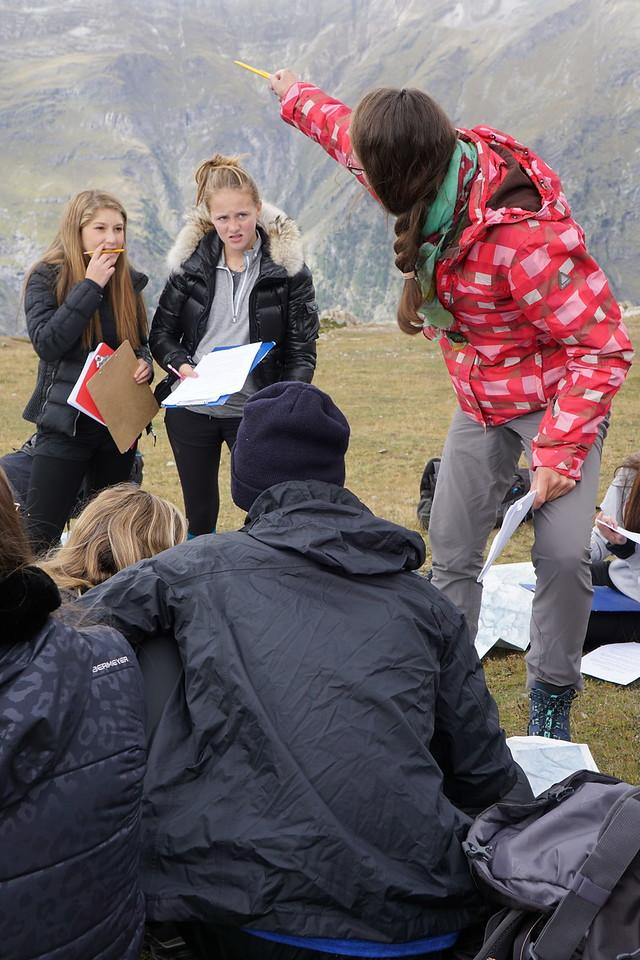 Ms. van Zalinge giving instructions to Alana and Emma