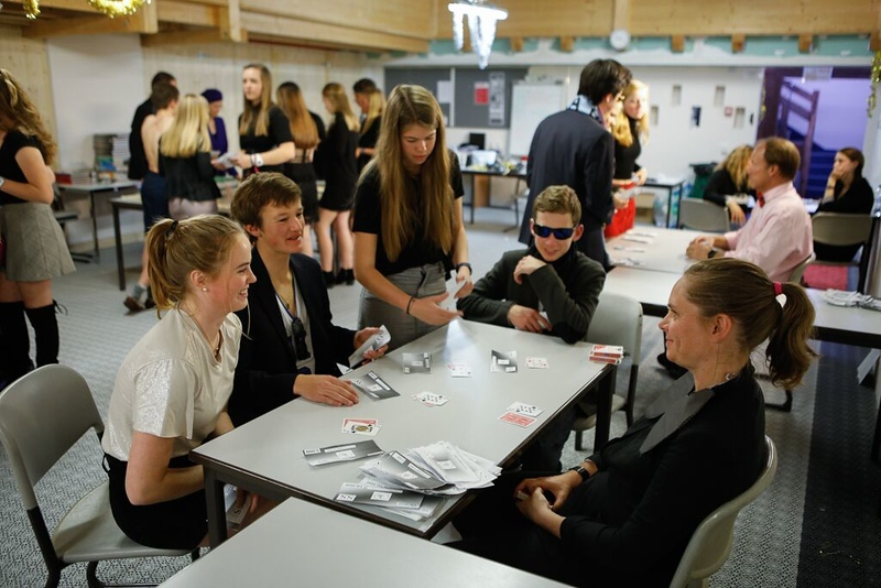 Ms. Kupka with Annika, Alex, Ellie, and Spencer at one of the Black Jack tables