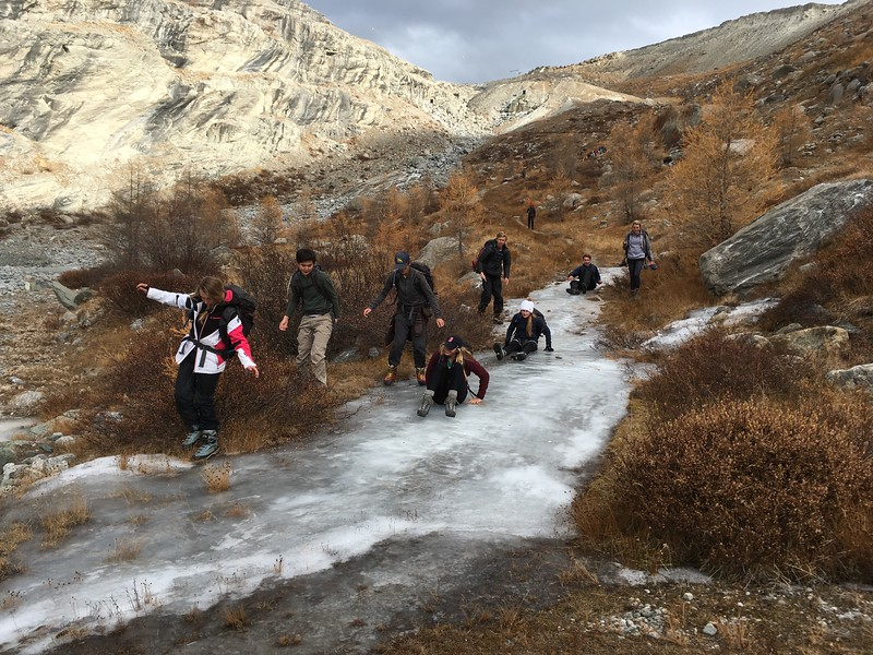 Camille, Mattias, Alex, McAuley, Rachel, Alden, Liam, and Brooke sliding on the ice coming down from the hike