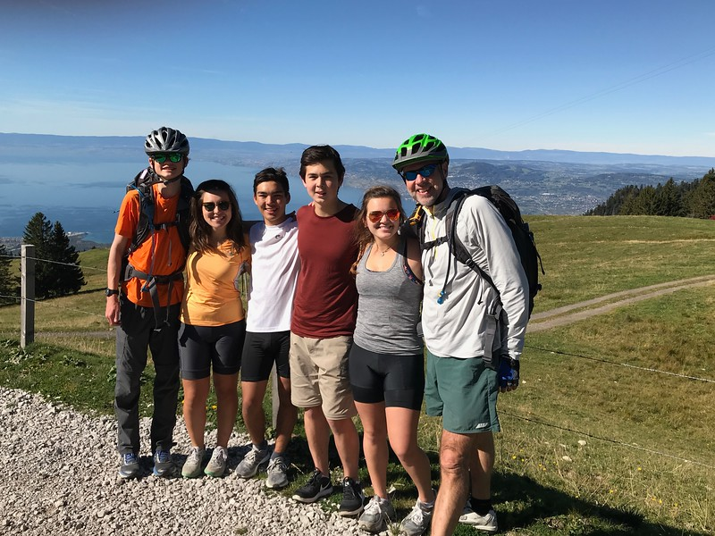 The Gruyères Bike Trip after all the uphills and getting ready to start the 40 minute downhill (really smiling!).  That is Lake Geneva in the background.