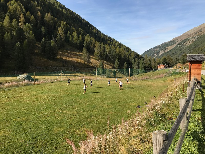Playing football on a field in Gruben