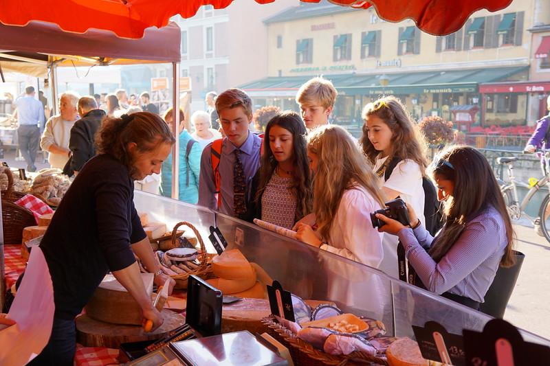 Michael, Nicole, Ryan, Ava, Trixie, and Francesca getting some cheese (a lot of cheese) at the Annecy market