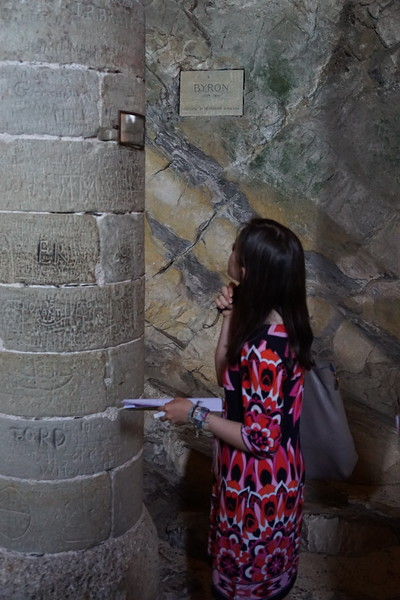 Aisling studying the pillar with Lord Byron's signature