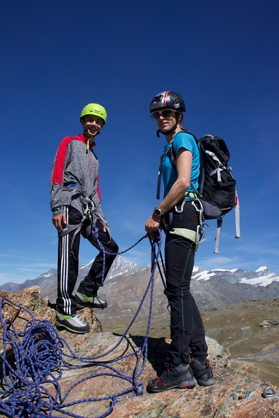 Aiden getting read to belay with Guide Bettina