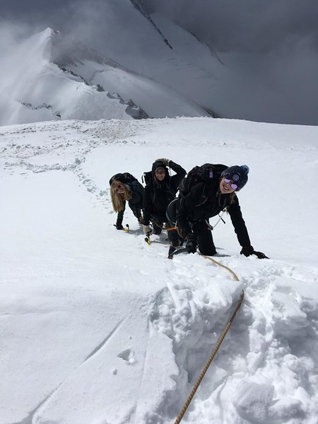 Madison, Mary Neely, and Ava heading up Alphubel using ice axes and crampons